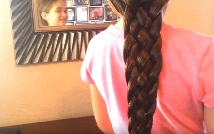 Single dad gives daughter epic braids