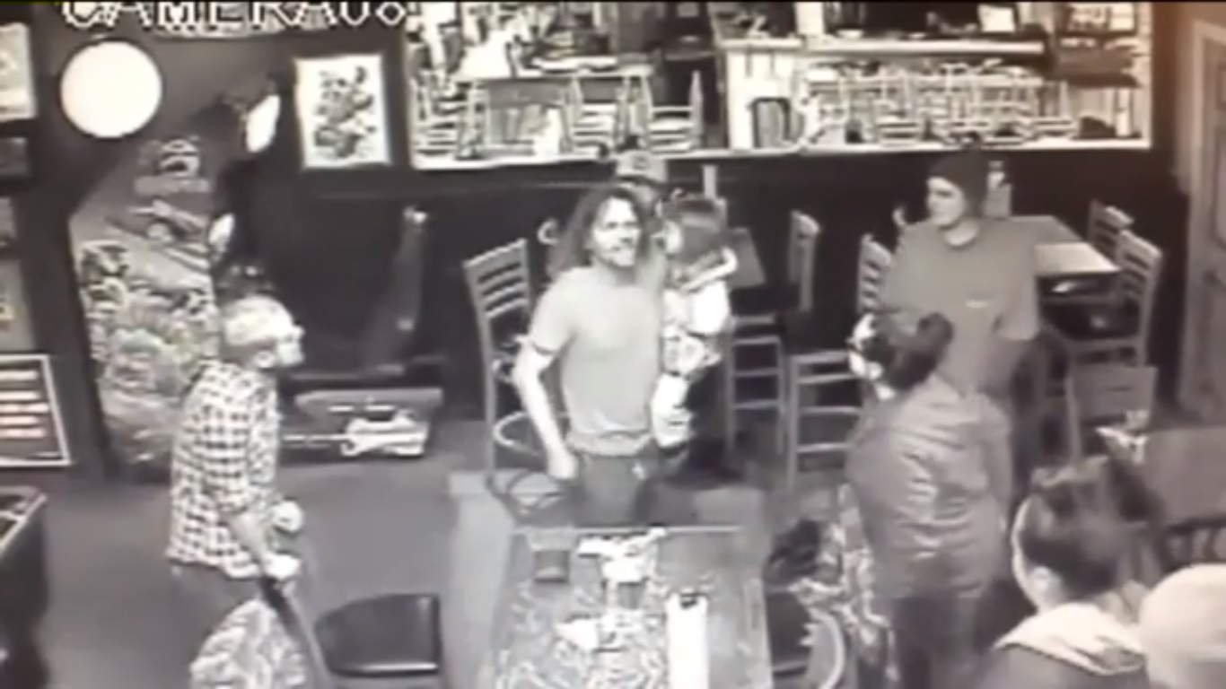 man starts bar fight holding four year old child